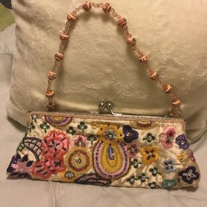 Beige evening bag with an embroidered design